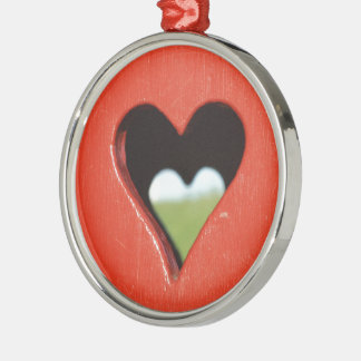 sawn out heart at red Holzwand Metal Ornament