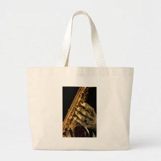 Saxofón con la mano del monstruo bolsa