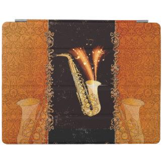 Saxofón con las notas dominantes y los elementos cover de iPad