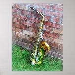 Saxofón contra ladrillo impresiones