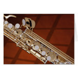 Saxofón del soprano en el oro tarjeta