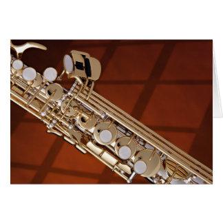 Saxofón del soprano en el oro tarjeta de felicitación