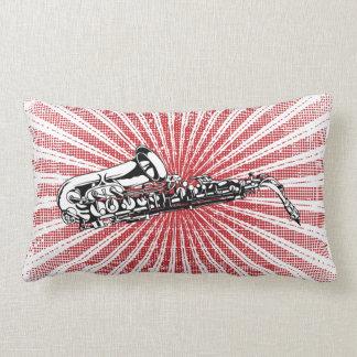 Saxofón en resplandor solar del rojo del Grunge Almohada