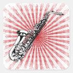 Saxofón en resplandor solar del rojo del Grunge Calcomanía Cuadradas Personalizada
