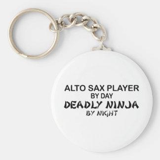 Saxofón Ninja mortal del alto por noche Llaveros