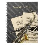 Saxofón y música del piano libros de apuntes con espiral