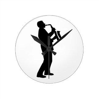 Saxofonista del jugador de saxofón reloj de pared