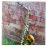 Saxophone Against Brick Ceramic Tiles