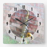 Saxophone Against Brick Wall Clocks