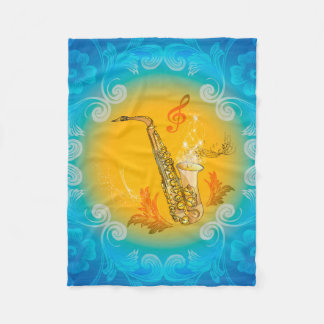 Saxophone with clef  in soft yellow, blue fleece blanket