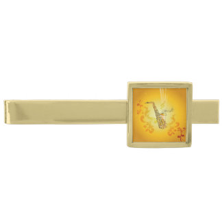 Saxophone with key notes and clef gold finish tie bar