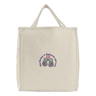 Sazonado con amor bolsa de mano bordada