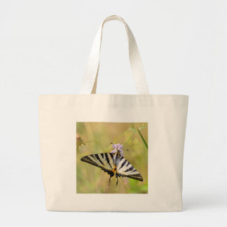 Scarce Swallowtail butterfly on flower Large Tote Bag