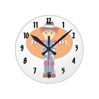 scarecrow cartoon orange behind round clock
