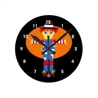 scarecrow cartoon orange behind round wallclock