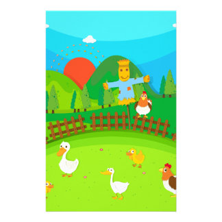 Scarecrow in the field full of ducks and chicken stationery