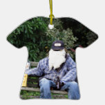 Scarecrow on bench with beer ornaments