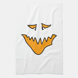 Scary Face. Monster Grin in Orange on White Kitchen Towel