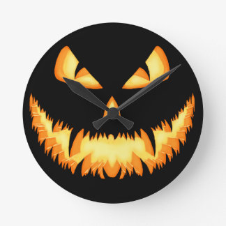 Scary Jack O Lantern with an evil grin and hungry Round Wall Clock