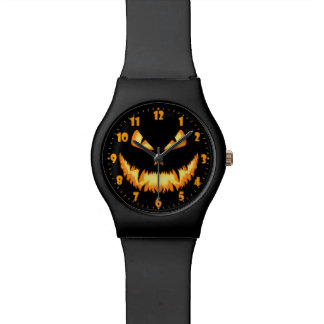 Scary Jack O Lantern with an evil grin and hungry Wristwatches