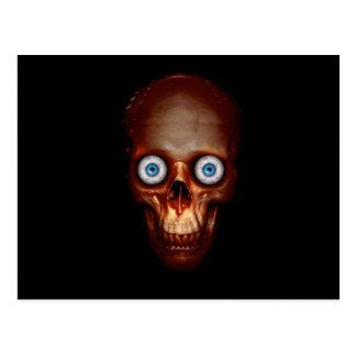 Scary skull in the dark postcard