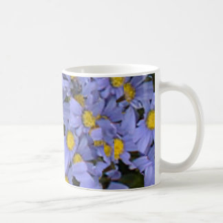 Scattered bunch of blue daisies, very pretty! coffee mug
