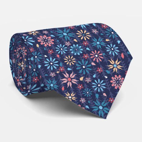 Scattered pastel flowers on dark blue background tie