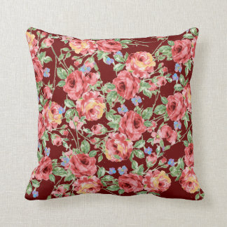 Scattered Roses Throw Pillow on Burgundy Field