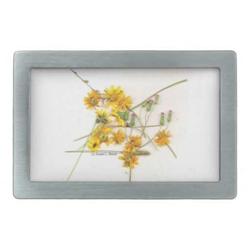 Scattered wildflowers in yellow and white belt buckles