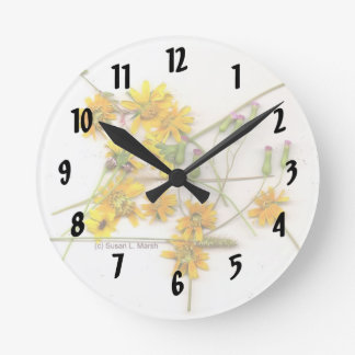 Scattered wildflowers in yellow and white round clock