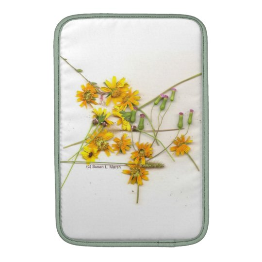 Scattered wildflowers in yellow and white MacBook sleeve