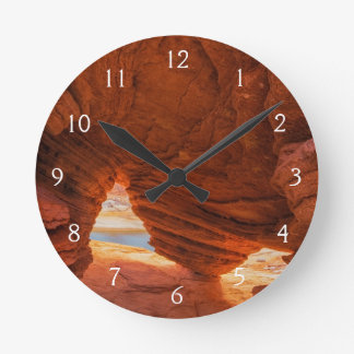 Scenic of eroded sandstone cave round clocks