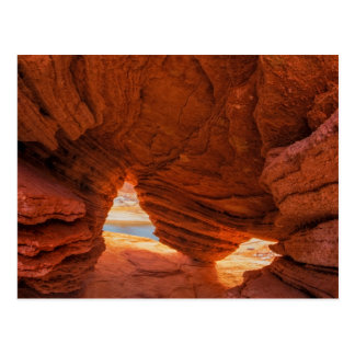 Scenic of eroded sandstone cave postcard