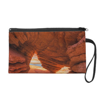 Scenic of eroded sandstone cave wristlet purse