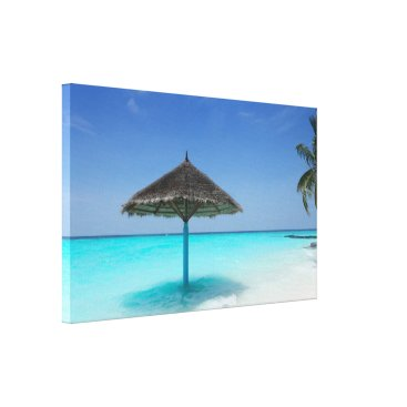 Scenic Tropical Beach with Thatched Umbrella Canvas Print
