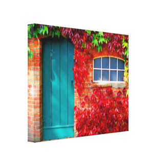Scenic Turquoise Door with Vivid Autumn Leaves Canvas Print