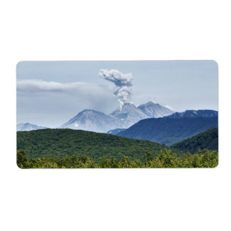 Scenic volcanic eruption and green forest label