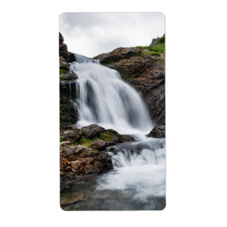 Scenic waterfall in mount cold river label