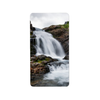 Scenic waterfall in mountain river label