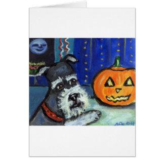 Schnauzer investigates glowing pumpkin Halloween Greeting Card