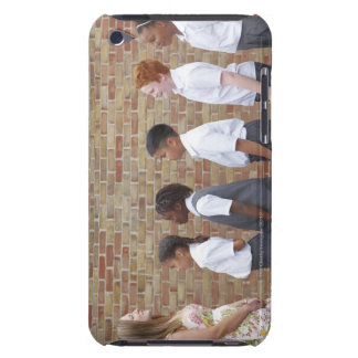 School children lining up in the playground for barely there iPod cover