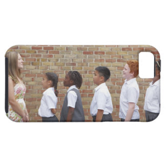 School children lining up in the playground for iPhone 5 case
