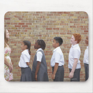 School children lining up in the playground for mouse pad