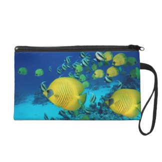 School of Butterfly Fish Swimming on the Seabed Wristlet Purse