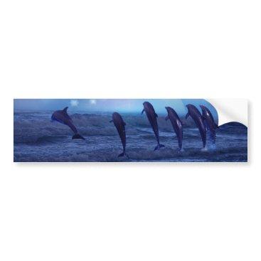 Beach Themed School of dolphins by moonlight bumper sticker