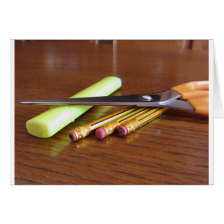 School office supplies on wooden table card