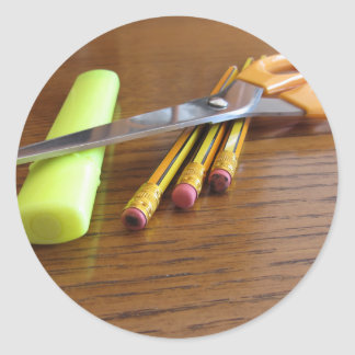 School office supplies on wooden table classic round sticker