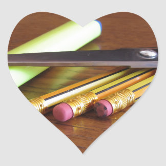School office supplies on wooden table heart sticker