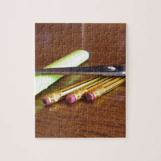 School office supplies on wooden table jigsaw puzzle