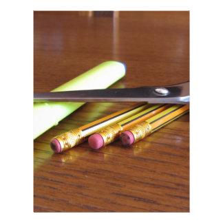 School office supplies on wooden table letterhead